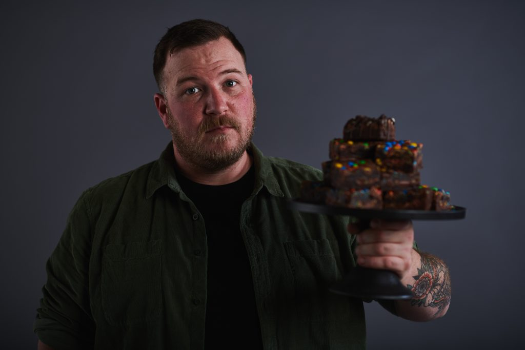 Robert Campbell, Ox Rabbit bakery holding chocolate brownies baked in melbourne